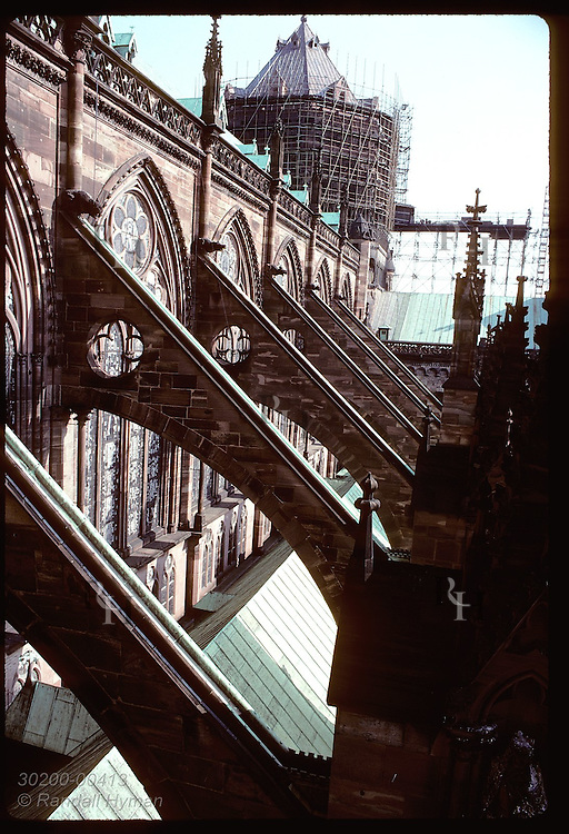 Tower view of the flying buttresses that line upper portion of the Cathedral in Strasbourg. France