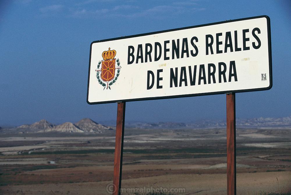 Sign over looking the barren landscape of Bardenas Reales de Navarra, Spain.