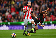 Jese of Stoke city battles for the ball with Alex Oxlade-Chamberlain of Arsenal. Premier league match, Stoke City v Arsenal at the Bet365 Stadium in Stoke on Trent, Staffs on Saturday 19th August 2017.<br /> pic by Bradley Collyer, Andrew Orchard sports photography.