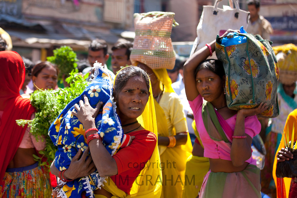 Indian women shopping in old town Udaipur, Rajasthan, Western India, Hindus and Muslims together.