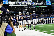 Penn State Nittany Lions captains punter Blake Gillikin (93) middle linebacker Jan Johnson (36) safety Garrett Taylor (17) outside linebacker Cam Brown (6) walk onto the field during the game of the NCAA Cotton Bowl Classic football game against the Memphis Tigers, Saturday, Dec. 28, 2019 at AT&T Stadium in Arlington, Texas. Penn State defeated Memphis 53-39. (Mario Terrana/Image of Sport)