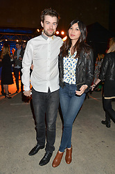 JACK WHITEHALL and GEMMA CHAN at the Battersea Power Station Annual Party at Battersea Power Station, 188 Kirtling Street, London SW8 on 30th April 2014.