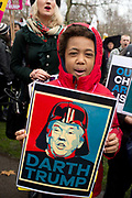 Stop Trump's Muslim ban demonstration on 4th February 2017 in front of the US Embassy in Grosvenor Square, London, United Kingdom. The protest was called on by Stop the War Coalition, Stand Up to Racism, Muslim Association of Britain, Muslim Engagement and Development, the Muslim Council of Britain, CND and Friends of Al-Aqsa. Thousands of demonstrators gathered to demonstrate against Trumps ban on Muslims, saying it must be opposed by all who are against racism and support basic human rights, and for Theresa May not to collude with him. A young boy holds a placard saying Darth Trump.