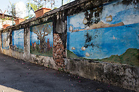 George Town Penang Street Art started with Penang's Georgetown Festival in 2012.  Beginning then, crumbling old walls gained a new lease of life.  Most of the more artistic murals and street art were created by a Lithuanian artist Ernest Zacharevic who was living in Penang at the time.  His artworks are humorous but at the same time open to interpretation.  Besides the paintings and murals, there are also steel rod wire sculptures scattered around the old sections of George Town with more local and somewhat less artistic themes.