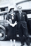 man and woman standing happy in front of an automobile France ca 1930s