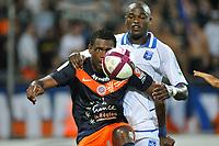 FOOTBALL - FRENCH CHAMPIONSHIP 2011/2012 - L1 - MONTPELLIER HERAULT SC v AJ AUXERRE - 06/08/2011 - PHOTO SYLVAIN THOMAS / DPPI - HENRI BEDIMO (MON) / DENNIS OLIECH (AJA)