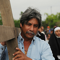 Rudy Cantu a perishiner from Emmaculate Heart of Mary Catholic Church walks down West Taylor Avenue Friday Morning during Stations of the Cross part of Easter celebrations in the Valley.