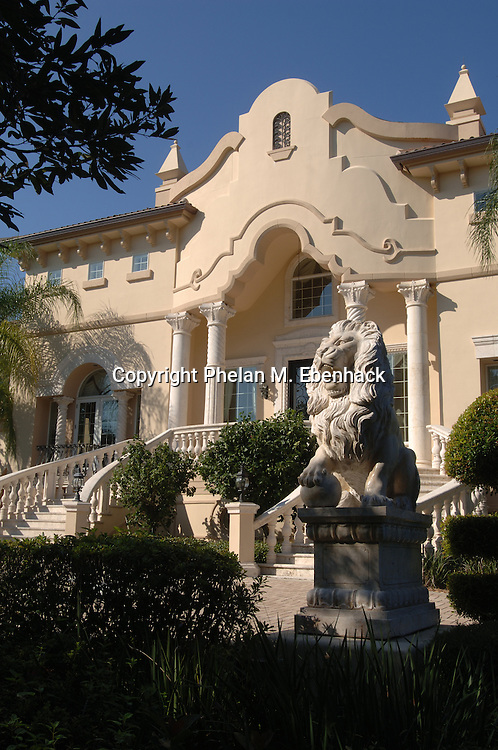 A stone lion and grand staircase lead to this three-story lakefront mansion, formerly owned by professional golfer Payne Stewart until his death in a plane accident, in Orlando, Florida.  After his death, the home was sold to former Orlando Magic basketball player Penny Hardaway.  It has since been sold to another buyer.