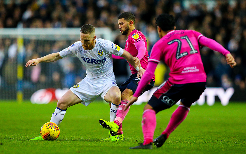 Leeds United's Adam Forshaw holds off the challenge from Queens Park Rangers' Nahki Wells<br /> <br /> Photographer Alex Dodd/CameraSport<br /> <br /> The EFL Sky Bet Championship - Leeds United v Queens Park Rangers - Saturday 8th December 2018 - Elland Road - Leeds<br /> <br /> World Copyright © 2018 CameraSport. All rights reserved. 43 Linden Ave. Countesthorpe. Leicester. England. LE8 5PG - Tel: +44 (0) 116 277 4147 - admin@camerasport.com - www.camerasport.com