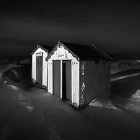 Southwold beach huts in the aftermath of a storm