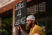 Brandon Pomerleau looks on outside the Hennepin County Government Center in advance of the sentencing of former Minneapolis Police officer Derek Chauvin in Minneapolis, Minnesota, on Friday, June 25, 2021.