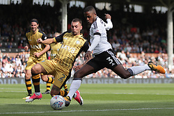 Sheffield Wednesday's Jack Hunt (left) attempts to prevent Fulham's Ryan Sessegnon from taking a shot at goal