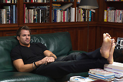 handsome barefoot man at home on the couch