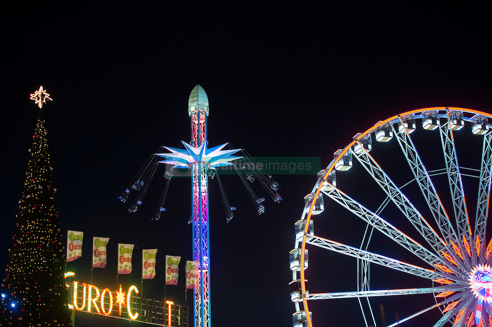 Visitors enjoy the rides and sights at Hyde Park Winter Wonderland in London.