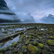 Milford Sound in Fjordland National Park with cloudy sky