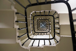 General view looking up the spiral staircase within the Elizabeth Tower, consisting of 334 steps, at the Palace of Westminster, London.