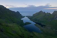 View over lake Ågvatn towards distant village of Å, Moskenesøy, Lofoten Islands, Norway