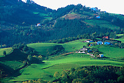 SPAIN, NORTH COAST, BASQUE REGION green, rolling hills, farms and villages in the countryside west of San Sebastian