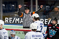 KELOWNA, BC - MARCH 26: Referee Ward Pateman raises his arms to call no goal at the Kelowna Rockets against the Victoria Royals at Prospera Place on March 26, 2021 in Kelowna, Canada. (Photo by Marissa Baecker/Shoot the Breeze)