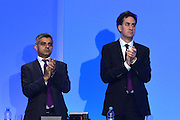 © Licensed to London News Pictures. 03/10/2012. Manchester, UK Sadiq khan, Shadow minister for crime stands an applauds with Leader of the Part Ed Miliband to applaud the two police officers killed in the line of duty recently in Manchester. Day 4 at The Labour Party Conference at Manchester Central today 3rd october 2012. Photo credit : Stephen Simpson/LNP