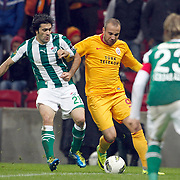 Galatasaray's Sercan YILDIRIM (C) and Bursaspor's Adem KOCAK (L) during their Turkish Super League soccer match Galatasaray between Bursaspor at the TT Arena at Seyrantepe in Istanbul Turkey on Sunday 16 October 2011. Photo by TURKPIX