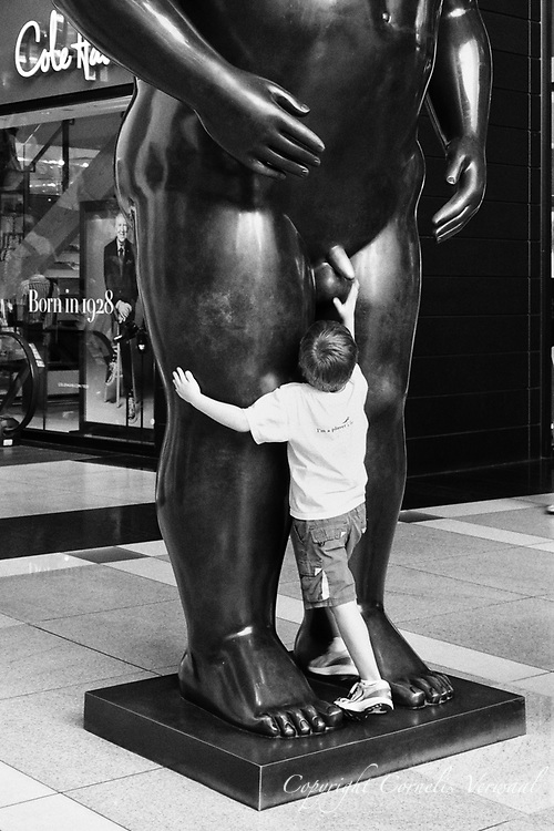 Adam and a curious boy  at the Time-Warner Center in New York City