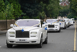 © Licensed to London News Pictures. 15/08/2020. Sheffield, UK. Cars lined up along Pitsmoor Road to pay tribute to Willy Collins as his funeral cortege passes through his childhood home town in Sheffield, South Yorkshire.Forty-nine-years-old, boxer, Willy Collins also known as the King of Sheffield, from Darnall, died sudenly while on the island of Majorca last month to celebrate his wife Kathleen's birthday. Photo credit: Ioannis Alexopoulos/LNP