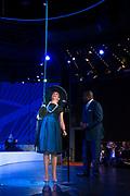 Koningin Maxima doopt het cruiseschip ms Koningsdam van Holland America Line in Rotterdam.<br /> <br /> Queen Maxima at the cruise ship ms Koningsdam Holland America Line in Rotterdanm for namen the ship.<br /> <br /> op de foto / On the photo:  Koningin Maxima bij de officiele ceremonie op  het cruiseschip ms Koningsdam van Holland America Line. met  kapitein de Vries, Stein Kruze en Orlando Ashford<br /> <br /> Queen Maxima at the official ceremony on the cruise ship MS Koningsdam Holland America Line. Captain de Vries, Stein Kruze and Orlando Ashford