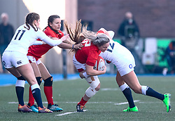 Hannah Bluck of Wales is tackled by en12/<br /> <br /> Photographer Simon King/Replay Images<br /> <br /> Six Nations Round 3 - Wales Women v England Women - Sunday 24th February 2019 - Cardiff Arms Park - Cardiff<br /> <br /> World Copyright © Replay Images . All rights reserved. info@replayimages.co.uk - http://replayimages.co.uk