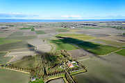 Nederland, Friesland, Gemeente Ferweradeel, 28-02-2016; Hegebeintum (Hogebeintum), Harsta State met naastgelegen boerderij. De State is een stins, historisch landhuis. In de achtergrond de Waddenzee.<br /> Harsta mansion with adjacent farm, northern Friesland.<br />  <br /> luchtfoto (toeslag op standard tarieven);<br /> aerial photo (additional fee required);<br /> copyright foto/photo Siebe Swart