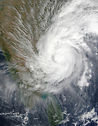 Southeast Indian State of Andhra Pradesh raked by Tropical Cyclone 03B in early 16 December 2003. The storm's winds, heavy rains, and cool temperatures, forced nearly 20,000 people to flee their homes. Credit NASA.
