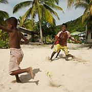 Papua kids playing football.