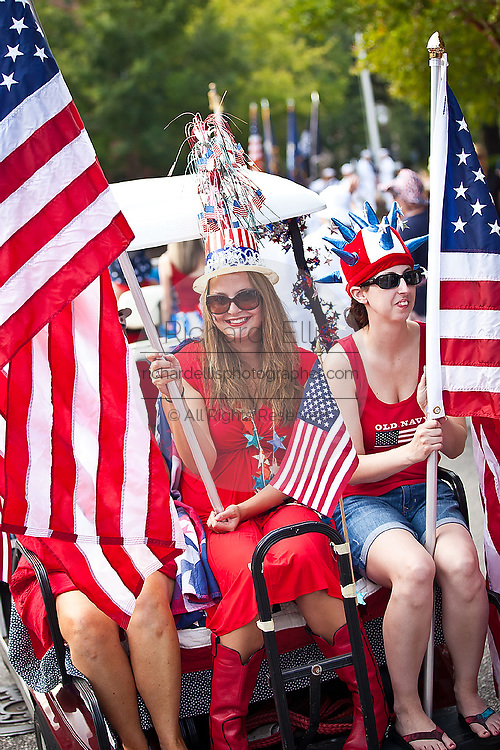 A woman dressed in patriotic costume in the I'On Community 4th of July parade.