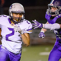 Kirtland Central Bronco Jaedan Alfred (2) pulls away from the reach of Miyamura Patriot Giovanni Chioda (18) Friday at Angelo DiPaolo Stadium in Gallup.