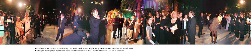Graydon Carter surveys scene during the  Vanity Fair Oscar  night party.Mortons, Los Angeles. 23 March 1988<br /> Copyright Photograph by Dafydd Jones<br /> 66 Stockwell Park Rd. London SW9 0DA<br /> Tel. 0171 733 0108