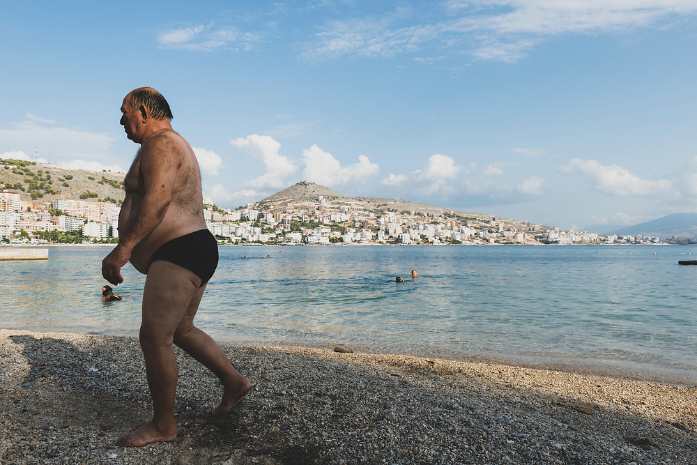 Sarande, Albania - September 11, 2013: Late summer day at the beach beside the Ionian Sea in Sarandë (Saranda), Albania.