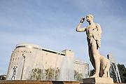 Spain, Catalonia, Barcelona, Placa de Catalunya, a fountain, sculpture Shepherd with Flute by Pau Gargallo (1927) and in the background El Corte Ingles department store