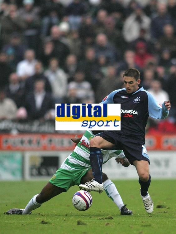 Photo: Lee Earle.<br />Yeovil Town v Swansea City. Coca Cola League 1. 27/10/2007. Swansea's Angel Rangel (R) battles with James Walker.