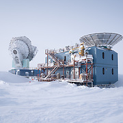 The Dark Sector Lab with the South Pole Telescope on left and BICEP3 on the right.
