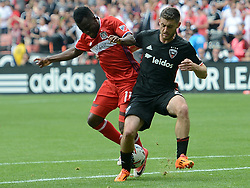May 20, 2017 - Washington, DC, USA - 20170520 - Chicago Fire midfielder DAVID ACCAM (11) and D.C. United defender CHRIS KORB (22) tangle as they vie for the ball in the first half at RFK Stadium in Washington. (Credit Image: © Chuck Myers via ZUMA Wire)