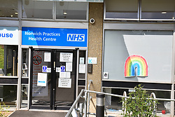 Health Centre with warning signs and rainbow drawing during Coronavirus lockdown, Norwich UK April 2020