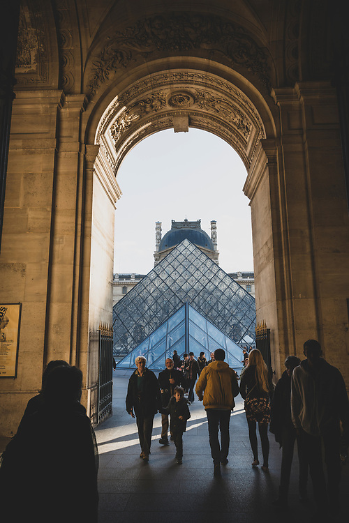 Pedestrians walk outside the Louvre, the world's largest art museum and a historic monument, in Paris, France.