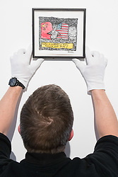 "Christies, St James, London, March 4th 2016. A gallery technician hangs Derek Boshier's ""Who Is Afraid Of Red, Yellow and Blue (II), in watercolour and black ink at the preview for the It's Our World charity auction at Christie's. Over 40 leading artists including David Hockney, Sir Antony Gormley, David Nash, Sir Peter Blake, Yinka Shonibare, Sir Quentin Blake, Emily Young and Maggi Hambling have committed artworks to the It's Our World Auction in support of The Big Draw and Jupiter Artland Foundation, to be sold at Christie's London on 10 March 2016.<br />  ///FOR LICENCING CONTACT: paul@pauldaveycreative.co.uk TEL:+44 (0) 7966 016 296 or +44 (0) 20 8969 6875. ©2015 Paul R Davey. All rights reserved."