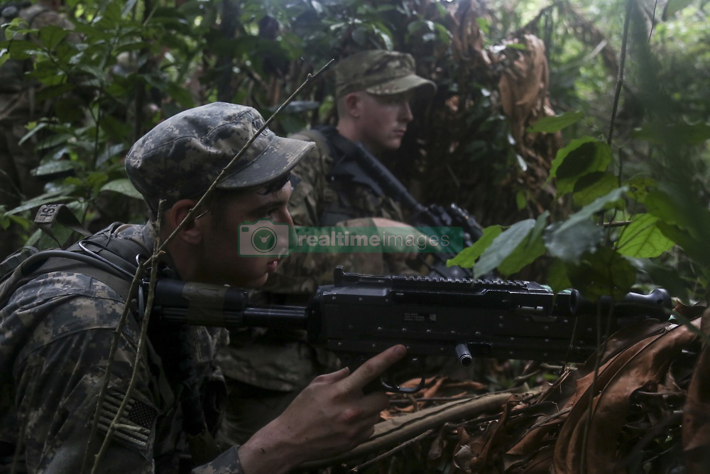 May 26, 2017 - Akim Oda, Ghana - Mud-caked, sweat-soaked and carrying minimal survival tools, soldiers from the 1st Battalion, 506th Infantry Regiment move through the dense brush of the Ghana's Achiase Jungle. The regionally aligned forces of U.S. Army Africa attended the Ghana armed forces-led Jungle Warfare School at Achiase military base in Akim Oda, Ghana, May 20-29. Ghana's military members have trained in jungle warfare for the past four decades. This year, they're instructing U.S. soldiers. Pictured: U.S. soldiers assigned to the 1st Battalion, 506th Infantry Regiment provide security during United Accord 2017 at the Jungle Warfare School at Achiase military base in Akim Oda, Ghana, May 26, 2017. (Credit Image: © Brian Chaney/DoD via ZUMA Wire/ZUMAPRESS.com)