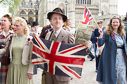 © London News Pictures. 08/05/15. London, UK. Reenactors dress in Second World War clothes as part of the VE Day celebrations, Central London. Photo credit: Laura Lean/LNP