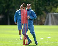 Photo: Daniel Hambury.<br />West Ham United Media Day. 10/08/2006.<br />Dean Ashton avoids the 'defender' during training.