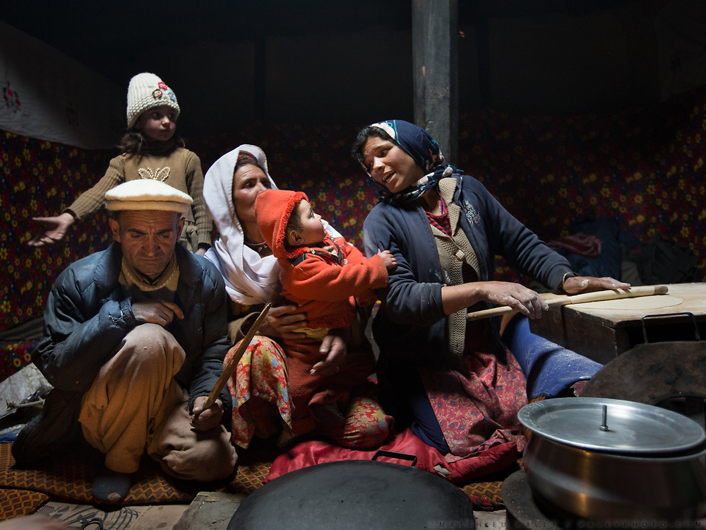 A family making Chappati sprinkled with Apricot oil at the house of Baba Jan & Rubina Ismail. In Shimshal, one of the remotest village in the Karakoram mountains, and the highest settlement in the Hunza and Gojal region.