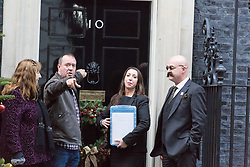 London, December 07 2017. Paula Williamson, new wife of long term prisoner Charles Bronson, who has been in prison for 43 years, of which 32 have been in solitary confinement, delivers a 22,000 signature petition to Downing Street, accompanied by a look alike of her husband. © Paul Davey