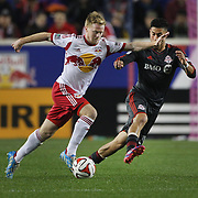 Dax McCarty, (left), New York Red Bulls, challenged by  Jonathan Osorio, Toronto FC, during the New York Red Bulls Vs Toronto FC, Major League Soccer regular season match at Red Bull Arena, Harrison, New Jersey. USA. 11th October 2014. Photo Tim Clayton