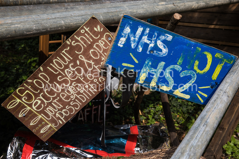 Denham, UK. 11th September, 2020. Two signs placed by environmental activists from HS2 Rebellion at Denham Protection Camp. Anti-HS2 activists continue to try to prevent or delay works on the controversial £106bn HS2 high-speed rail link from a series of such protection camps based along the route of the line between London and Birmingham.